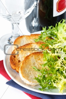 Crusty toasts and salad.