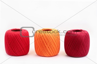 Three cotton spools