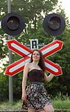 girl near railroad's sign