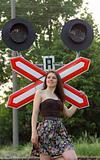 girl near railroad's sign
