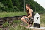 pretty girl near railroad's traffic sign