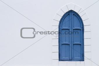 blue shutter window in white wall