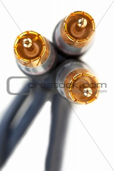 three gold plugs close-up