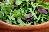 fresh salad mix in wooden bowl