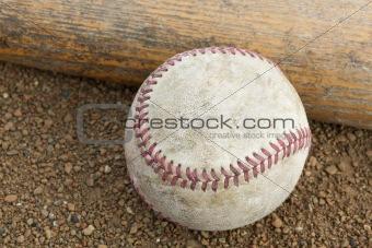 A worn baseball and bat