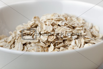 Dry oatmeal in a bowl
