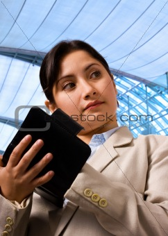 Business Woman Writing her Schedule in Her Organizer