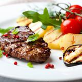 Grilled steak flavoured with pink peppercorns and basil