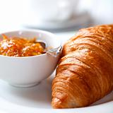 French croissant with orange jam