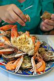 plate with cut crab and seafood