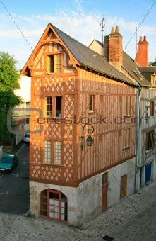old narrow corner timber framing house