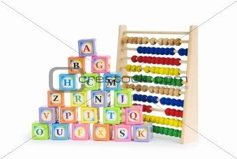 Alphabet blocks and abacus isolated on white