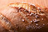salted bun on an oak table