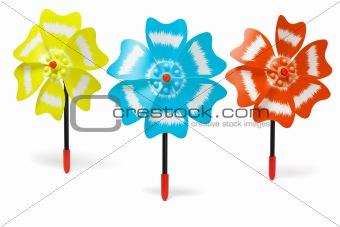 Three colorful toy windmills