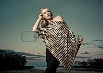 Beautiful Woman on Beach at Dusk