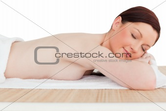 Beautiful red-haired female relaxing in a spa centre