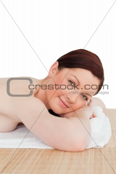 Attractive red-haired female relaxing in a spa centre