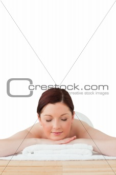 Attractive red-haired woman relaxing in a spa centre