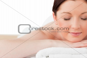 Beautiful red-haired woman posing while relaxing in a spa centre