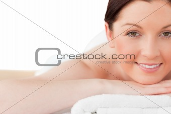 Attractive red-haired woman posing while relaxing in a spa centr