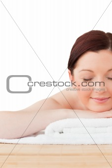 Charming red-haired woman posing while relaxing in a spa centre