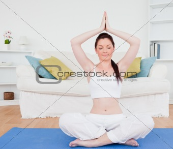 Beautiful female doing relaxation on a gym carpet