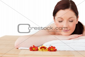 Portrait of an attractive red-haired woman posing while relaxing