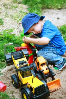 Boy playing with digger