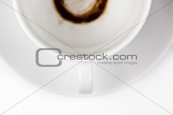 An empty white coffee cup