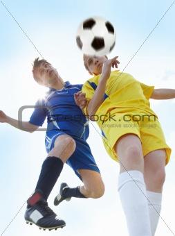 Footballers in jump