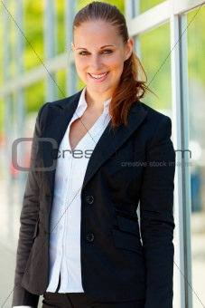 Portrait of smiling  business woman  at office building