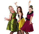 three young woman in bright colour dresses