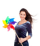 beautiful young woman holding a multicolored pinwheel - isolated on white