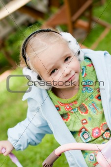Little girl playing outside