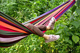 child lying in a hammock