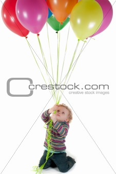 Little cute girl with multicolored air balloons