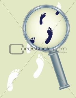 footprints under magnifier glass