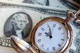 Old pocket watch on $2 bills -- Time is money