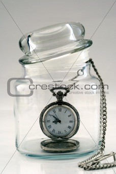 Old pocket watch in a glass jar – Time in a Bottle
