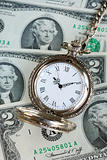 Old pocket watch on a stack of $2 bills -- Time is money