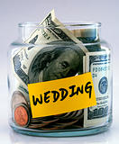 "A lot of money in a glass bottle labeled ""Wedding"""