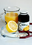 Rich in Vitamin C: orange juice, lemon, and supplement pills