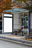 A bus stop with the advertisement removed