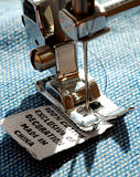 Putting the size label by a sewing machine