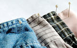 Different textures and colors of clothes with pins
