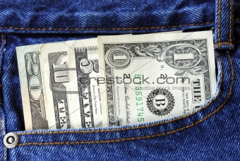 American money is in the pocket of blue jeans