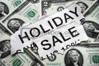 Holiday on sale signs with some $2 dollar bills
