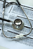 A stethoscope and the medical audit document