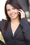 Beautiful Hispanic Businesswoman Using Cell Phone