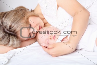Portrait of a young mother and baby